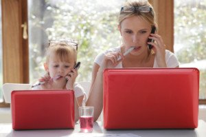 mother and girl with laptops